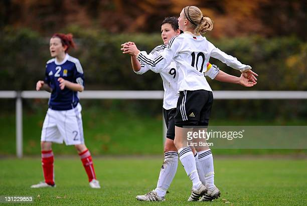 Jasmin Sehan of Germany celebrates with team mate Saskia Matheis after scoring a goal during the U15 Women's international friendly match between...