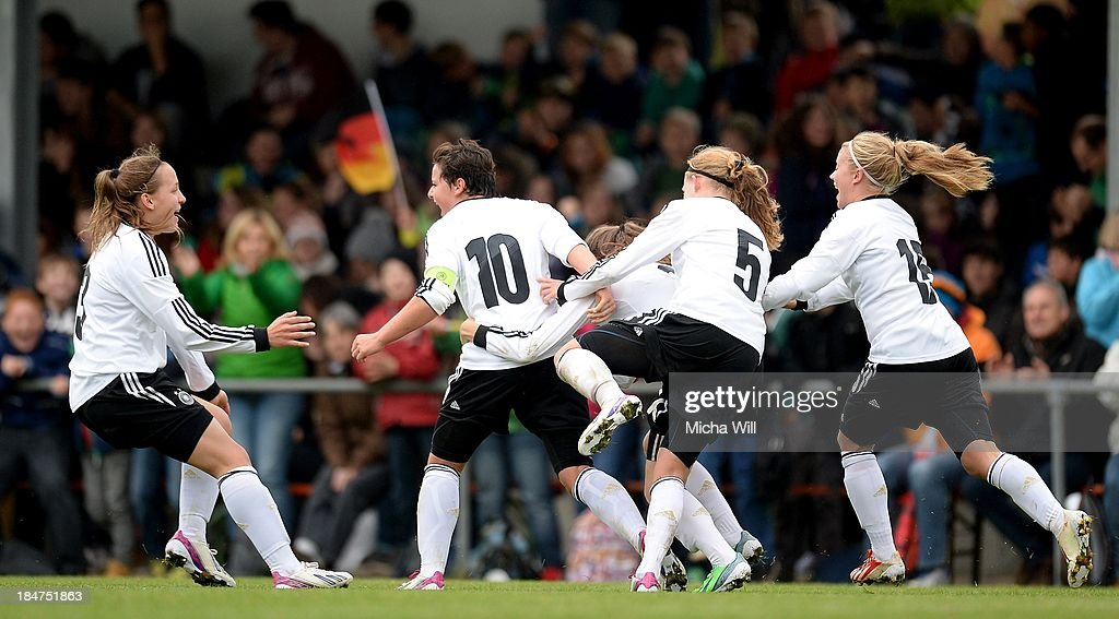 Jasmin Sehan (2nd L) of Germany celebrates with team-mates after scoring the opening/first goal during the U17 Girls Euro Qualifier match between Germany and Belgium at Bioenergie-Arena on October 16, 2013 in Grossbardorf, Germany.