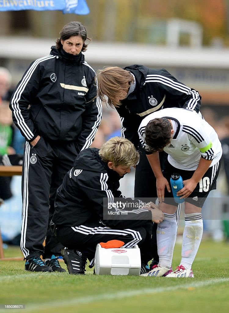 Jasmin Sehan of Germany is treated by the medics during the U17 Girls Euro Qualifier match between Germany and Belgium at Bioenergie-Arena on October 16, 2013 in Grossbardorf, Germany.