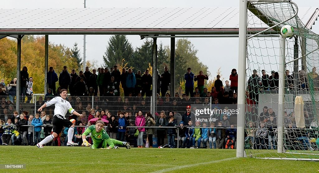 Jasmin Sehan (L) of Germany scores the opening goal during the U17 Girls Euro Qualifier match between Germany and Belgium at Bioenergie-Arena on October 16, 2013 in Grossbardorf, Germany.