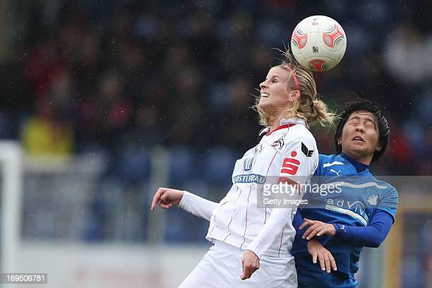 Jasmin Stuemper of Koeln jumps for a header with Mana Iwabuchi of Hoffenheim during the Women's Second Bundesliga match between TSG 1899 Hoffenheim...