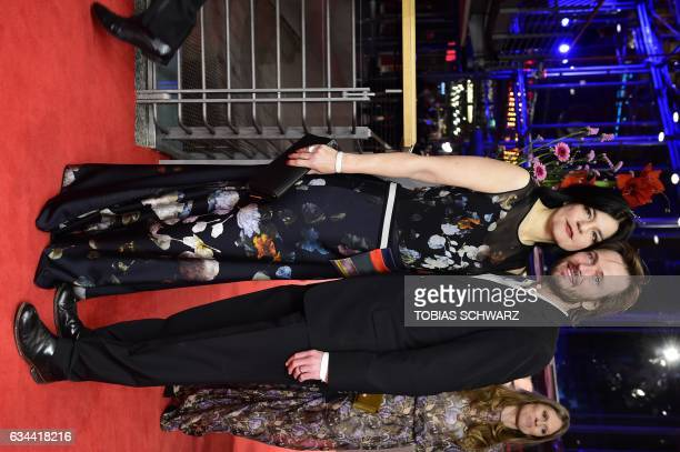 Jasmin Tabatabai and Ehemann Andreas Pietschmann arrive for the opening of the Berlinale film festival with the premiere of 'Django' during the 67th...