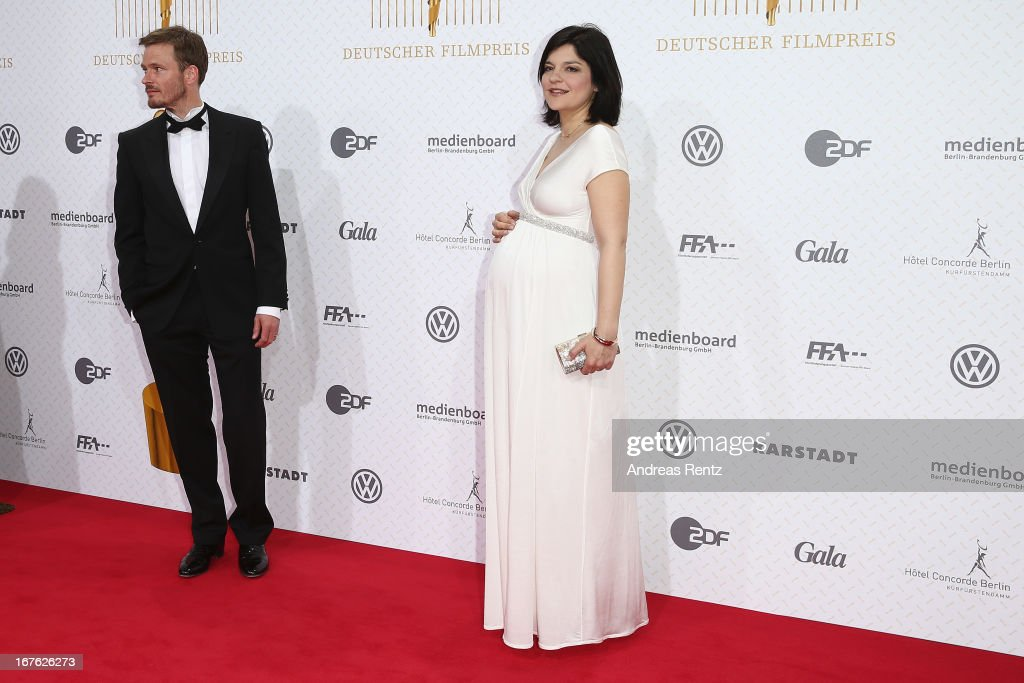 Jasmin Tabatabai and partner Andreas Pietschmann arrive for the Lola - German Film Award 2013 at Friedrichstadt-Palast on April 26, 2013 in Berlin, Germany.