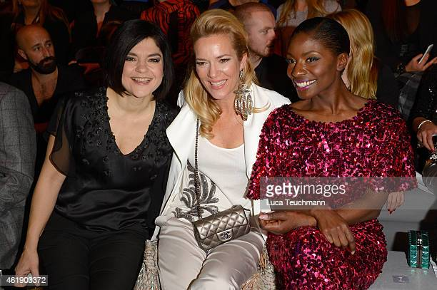 Jasmin Tabatabai Jessica Stockmann and Nikeata Thompson attend the Guido Maria Kretschmer show during the MercedesBenz Fashion Week Berlin...