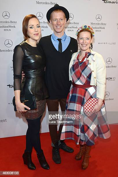 Jasmin Wagner Tobias Staerbo and Enie van de Meiklokjes attend the Glaw show during MercedesBenz Fashion Week Autumn/Winter 2014/15 at Brandenburg...