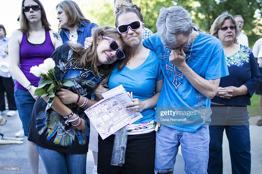 Jasmine Christman (L) stands with her mom Yolanda Vega Jordan and Jack Jordan at a remembrance ceremony at the Aurora Municipal Building to mark the one one-year anniversary of the Aurora Movie Theatre Shootings July 20, 2013 in Aurora, Colorado. James Holmes killed 12 people and injured more than 50 during a mass shooting in a movie theater in 2012.