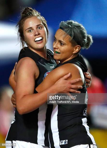 Jasmine Garner of the Magpies celebrates with Moana Hope of the Magpies during the 2017 AFLW Round 04 match between the Western Bulldogs and...