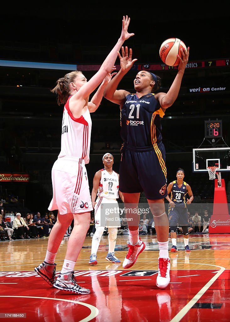 Jasmine Hassell #21 of the Indiana Fever shoots against Emma Meesseman #33 of the Washington Mystics at the Verizon Center on July 21, 2013 in Washington, DC.
