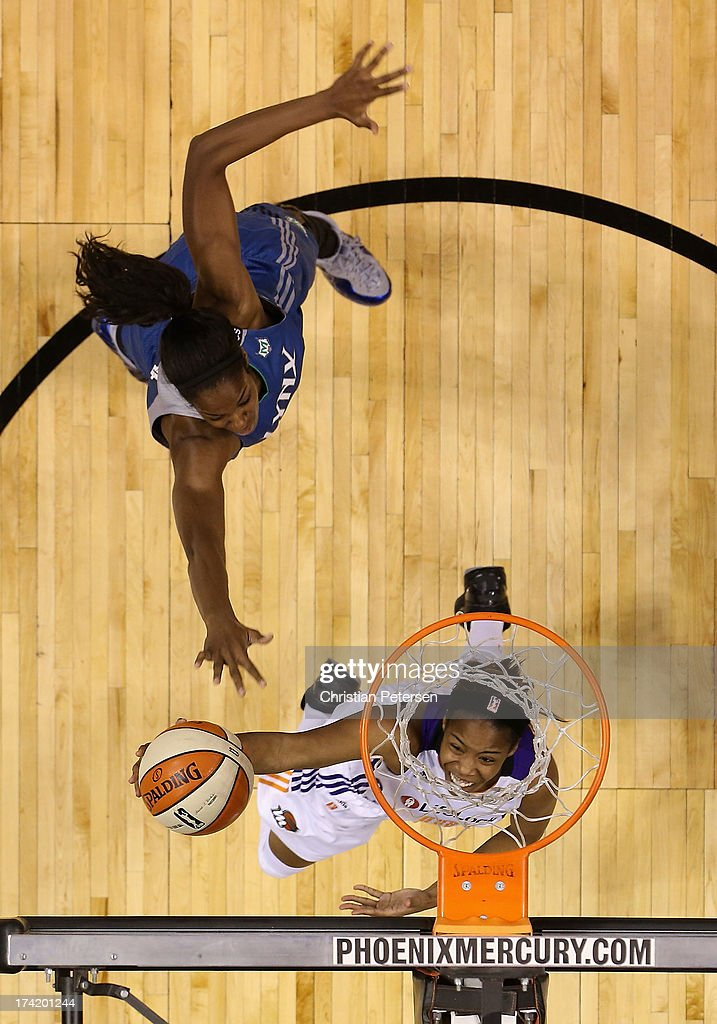 Jasmine James #10 of the Phoenix Mercury lays up a shot past Devereaux Peters #14 of the Minnesota Lynx during the second half of the WNBA game at US Airways Center on July 21, 2013 in Phoenix, Arizona. The Lynx defeated the Mercury 82-77.
