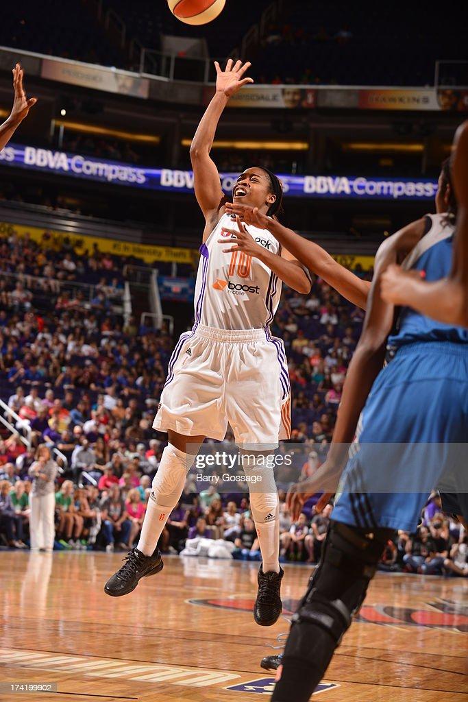 Jasmine James #10 of the Phoenix Mercury shoots against the Minnesota Lynx on July 21, 2013 at U.S. Airways Center in Phoenix, Arizona.