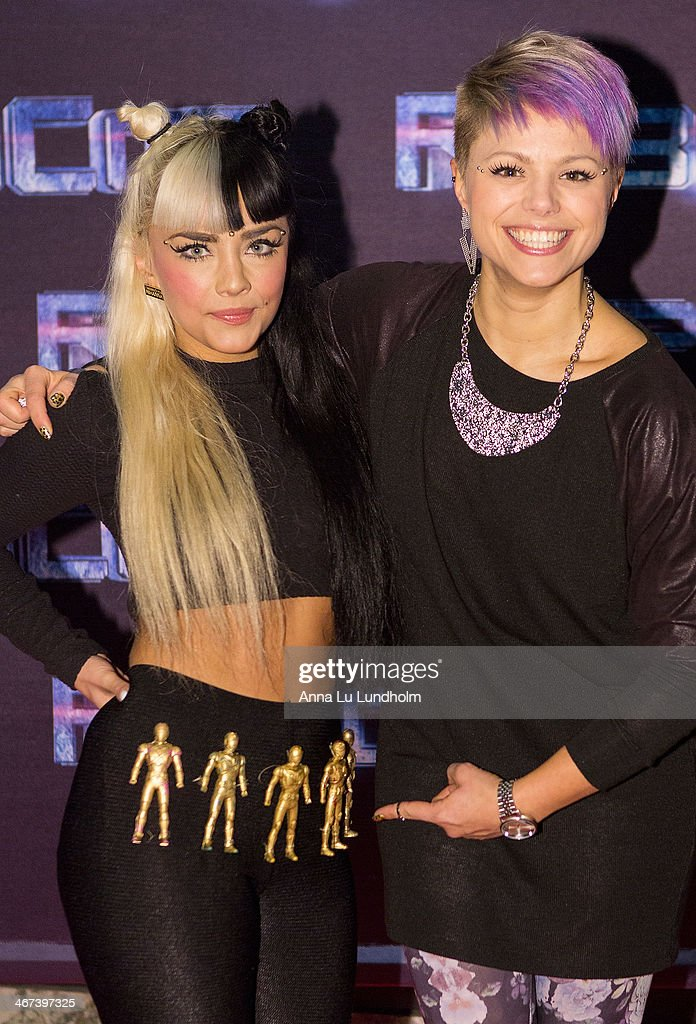 Jasmine Kara (L) with friend attends the Stockholm premiere of 'Robocop' at Rigoletto on February 6, 2014 in Stockholm, Sweden.