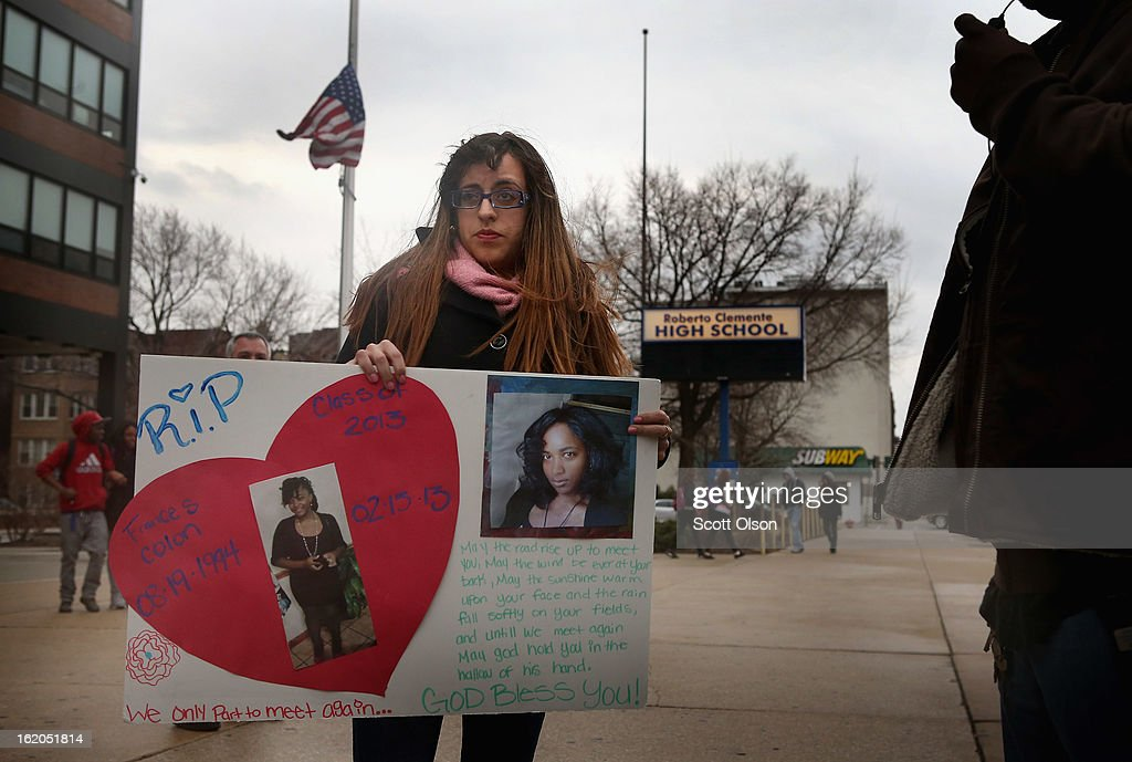 Jasmine Maymi leaves Roberto Clemente High school carrying a poster which is a tribute to her friend and classmate eighteen-year-old Frances Colon on February 18, 2013 in Chicago, Illinois. Colon, who was shot and killed on Friday, was the third student from Clemente High School, a Westside school with less than 800 students, to be murdered in the past three months. Colon was the 51st person murdered in Chicago in 2013.