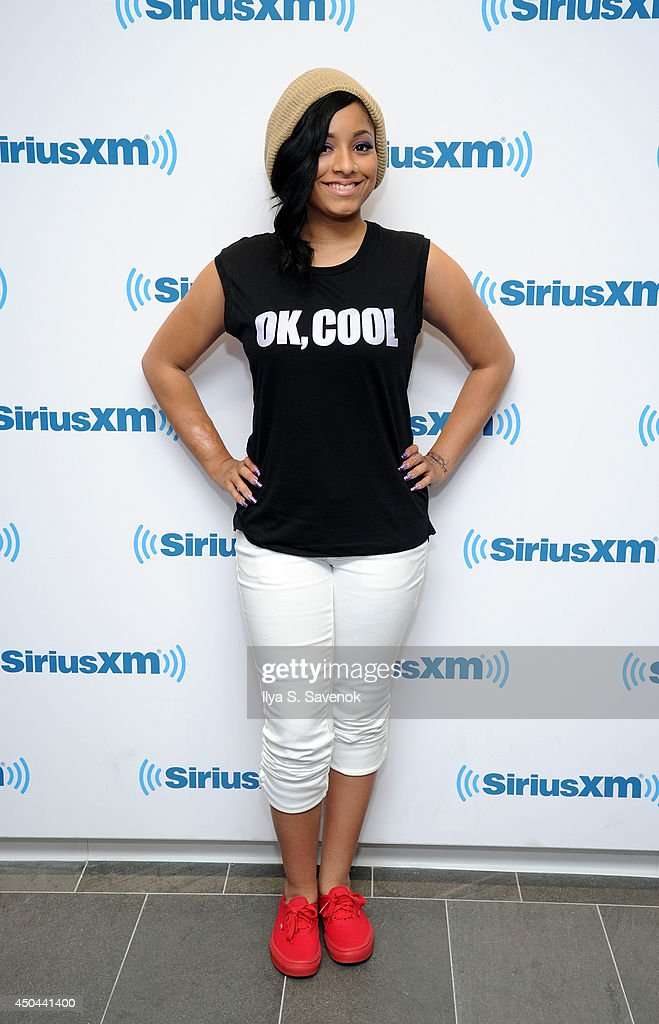 Jasmine Pore of the group Love Dollhouse visits the SiriusXM Studios on June 11, 2014 in New York City.