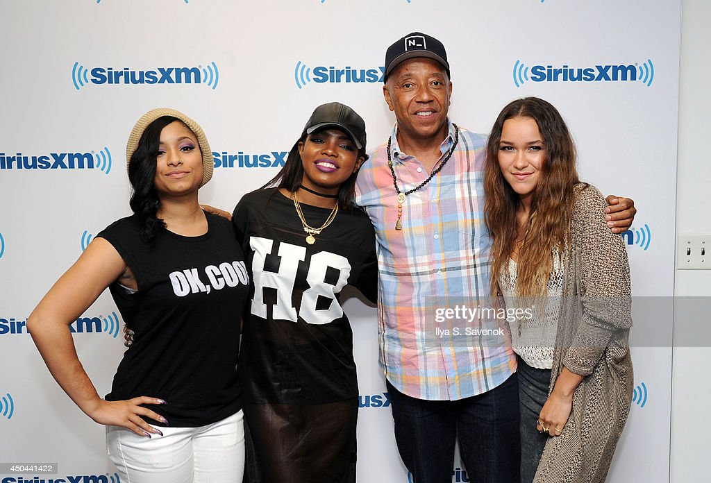 Jasmine Pore, Ryan Destiny and Chelsea Stone of the group Love Dollhouse pose with Russell Simmons at the SiriusXM Studios on June 11, 2014 in New York City.