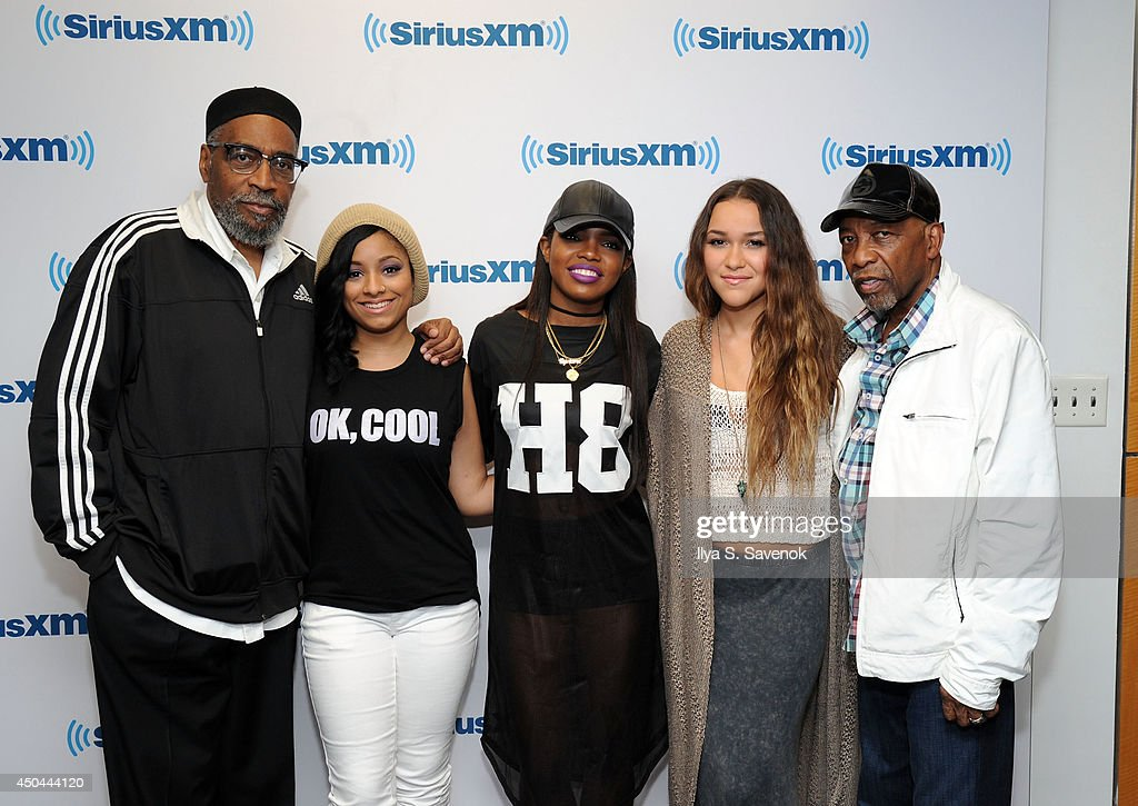 Jasmine Pore, Ryan Destiny and Chelsea Stone of the group Love Dollhouse pose with Kenny Gamble (L) and Leon Huff (R) at the SiriusXM Studios on June 11, 2014 in New York City.