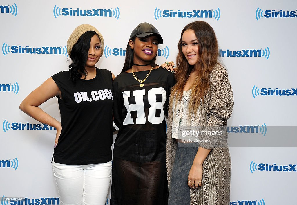 Jasmine Pore, Ryan Destiny and Chelsea Stone of the group Love Dollhouse visit the SiriusXM Studios on June 11, 2014 in New York City.