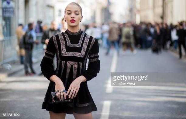 Jasmine Sanders wearing a black dress Dior bag is seen outside Dior during Paris Fashion Week Spring/Summer 2018 on September 26 2017 in Paris France