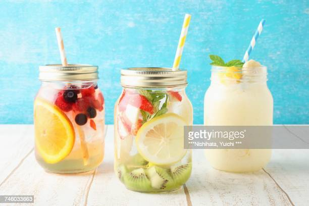 Jasmine tea with fruit, detox water, and a mango and banana smoothie
