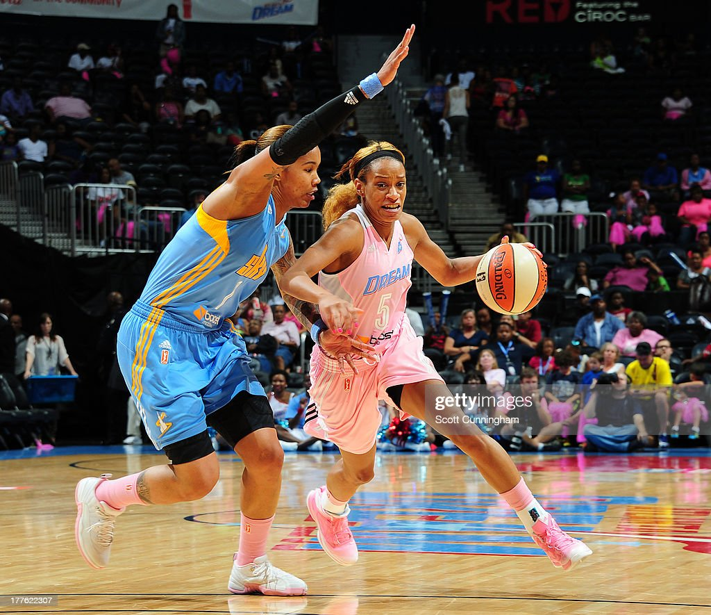 Jasmine Thomas #5 of the Atlanta Dream drives against Tamera Young #1 of the Chicago Sky at Philips Arena on August 24 2013 in Atlanta, Georgia.