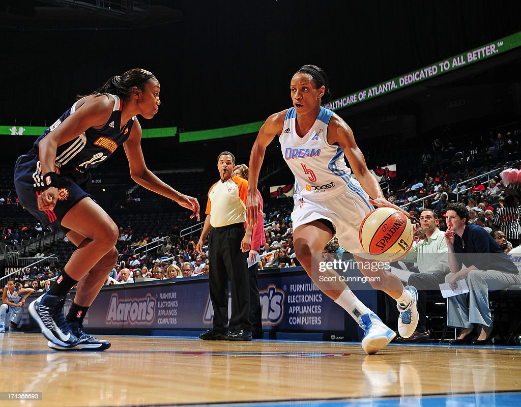Jasmine Thomas #5 of the Atlanta Dream drives against the Connecticut Sun at Philips Arena on July 24, 2013 in Atlanta, Georgia.