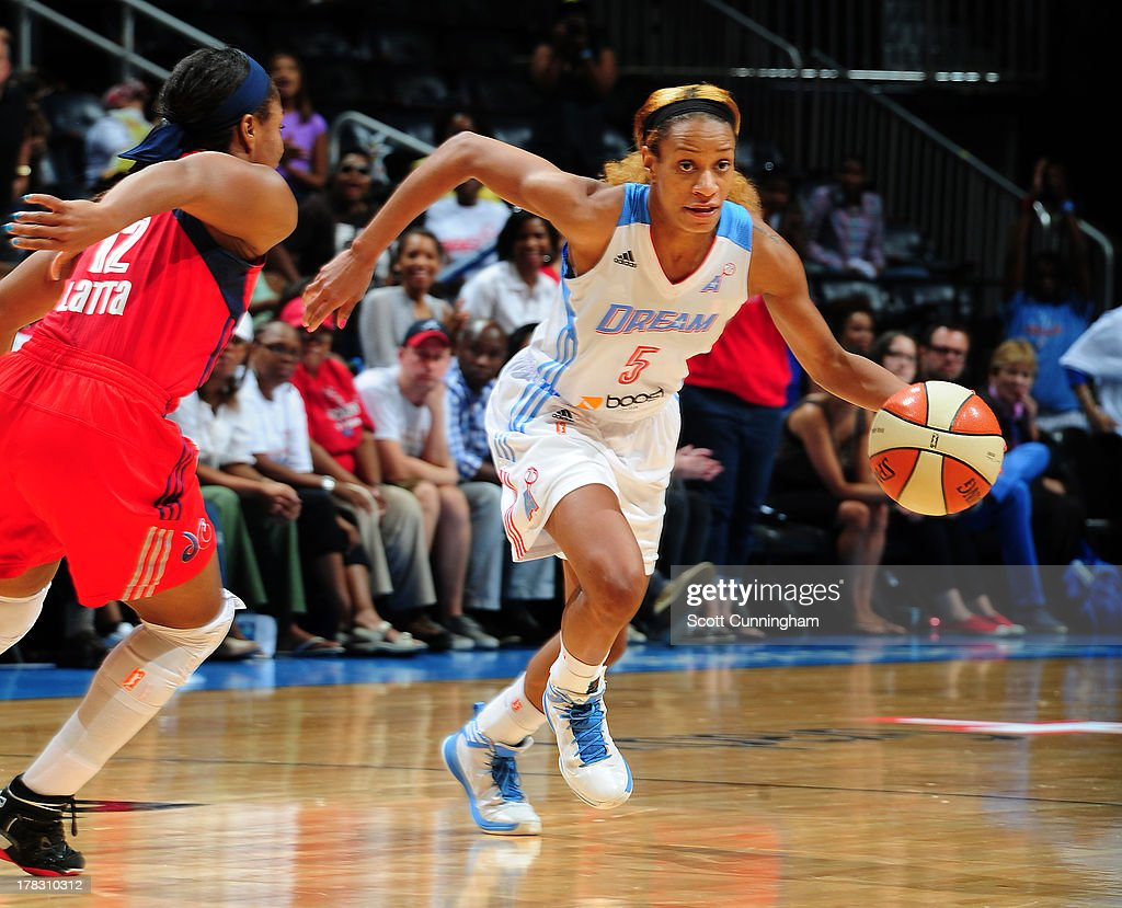 Jasmine Thomas #5 of the Atlanta Dream drives against the Washington Mystics at Philips Arena on August 28 2013 in Atlanta, Georgia.