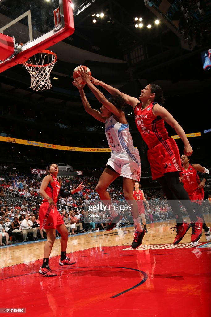 Jasmine Thomas #5 of the Atlanta Dream grabs a rebound against the Washington Mystics at Philips Arena on July 5, 2014 in Atlanta, Georgia.