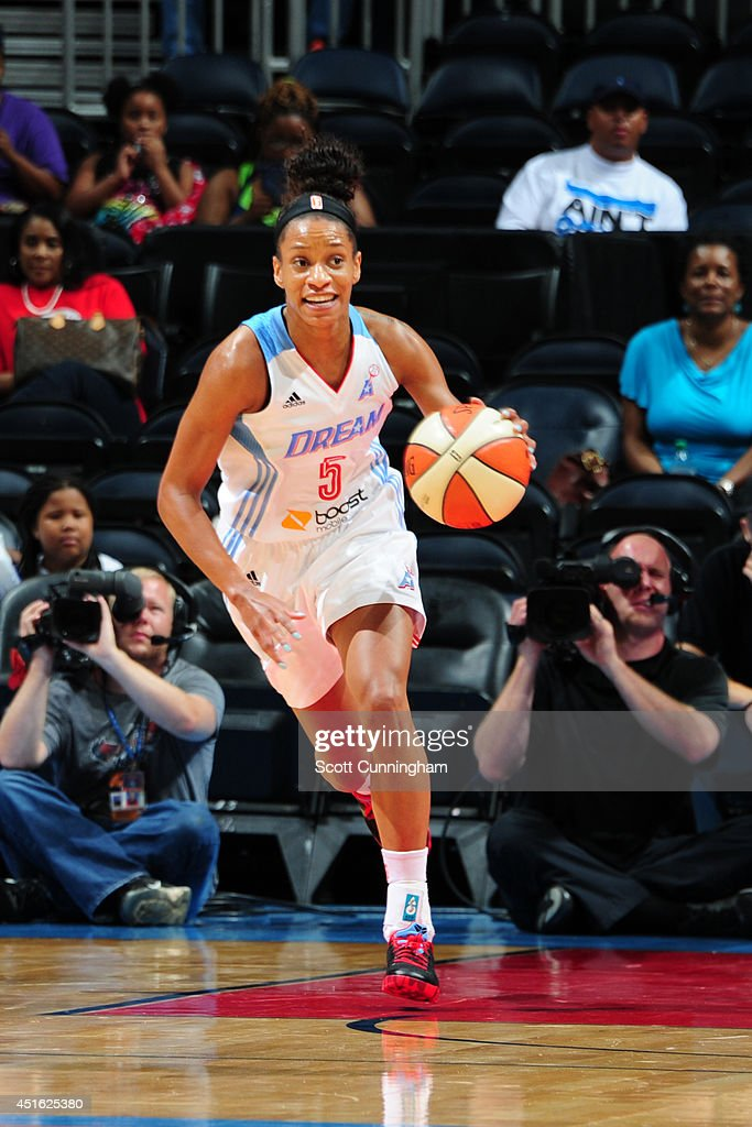 Jasmine Thomas #5 of the Atlanta Dream handles the ball against the Indiana Fever on July 1, 2014 at Philips Arena in Atlanta, Georgia.