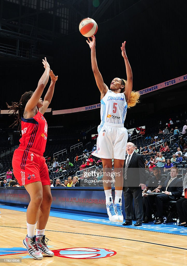Jasmine Thomas #5 of the Atlanta Dream puts up a shot against the Washington Mystics at Philips Arena on August 28 2013 in Atlanta, Georgia.