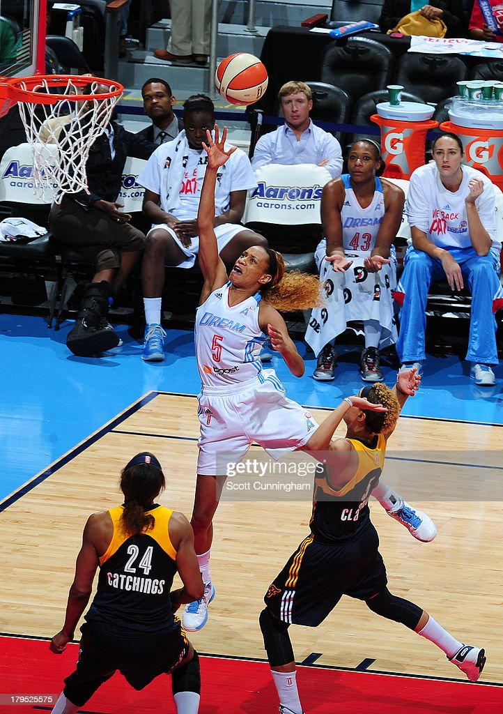 Jasmine Thomas #5 of the Atlanta Dream puts up a shot against the Indiana Fever at Philips Arena on September 4 2013 in Atlanta, Georgia.
