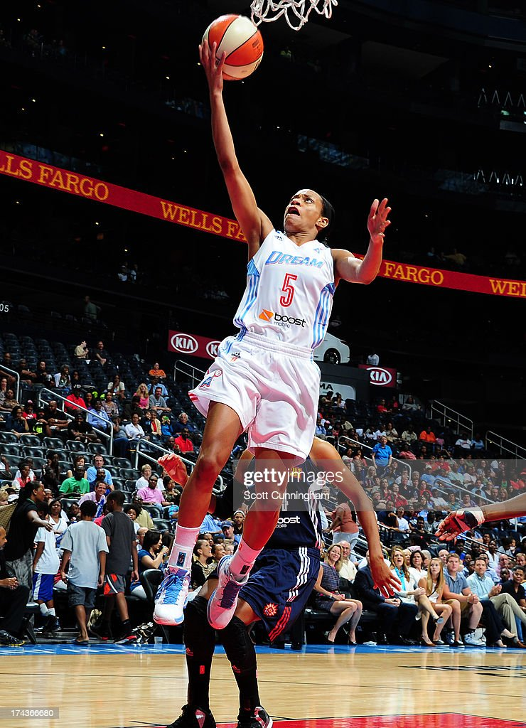 Jasmine Thomas #5 of the Atlanta Dream puts up a shot against the Connecticut Sun at Philips Arena on July 24, 2013 in Atlanta, Georgia.