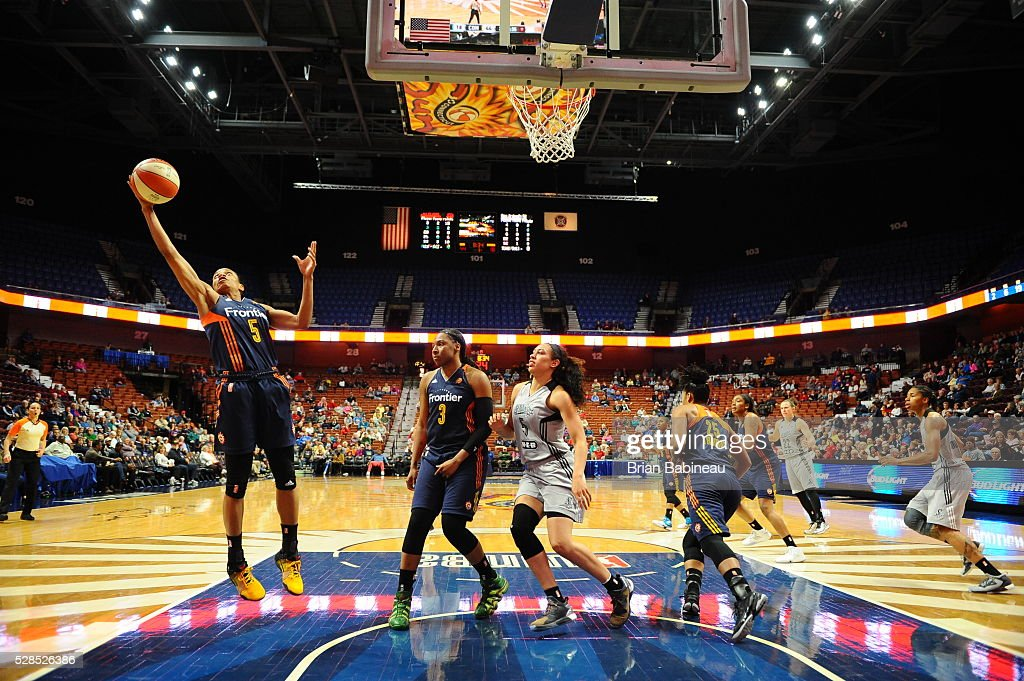Jasmine Thomas #5 of the Connecticut Sun grabs the rebound against the San Antonio Stars in a WNBA preseason game on May 5, 2016 at the Mohegan Sun Arena in Uncasville, Connecticut.