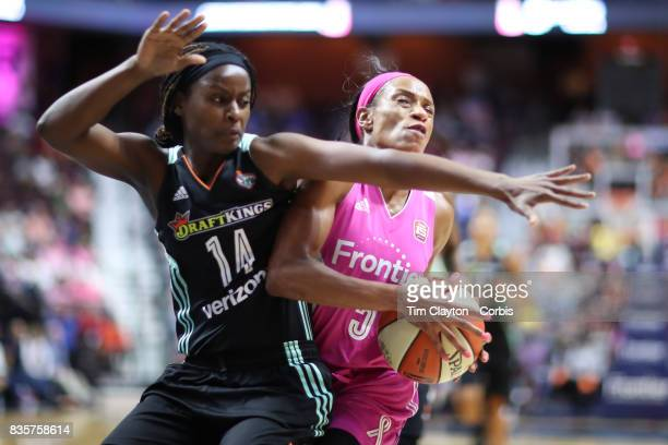 Jasmine Thomas of the Connecticut Sun is fouled by Sugar Rodgers of the New York Liberty during the Connecticut Sun Vs New York Liberty WNBA regular...
