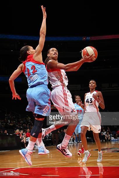Jasmine Thomas of the Washington Mystics shoots against Armintie Price of the Atlanta Dream at the Verizon Center on September 14 2012 in Washington...