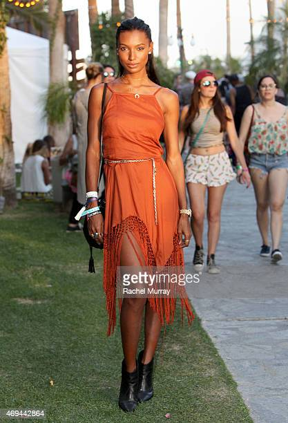 Jasmine Tookes in an Urban Outfitters dress and Rag and Bone boots attends the 2015 Coachella Valley Music and Arts Festival Weekend 1 at The Empire...