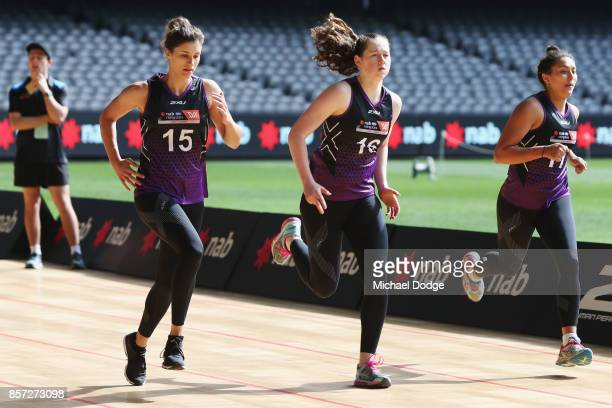 Jasmyn Hewett of StMary's and Jessica Allen of Glenelg take part in the YoYo run during the AFLW Draft Combine at Etihad Stadium on October 4 2017 in...