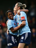 Jasmyne Spencer of Sydney FC celebrates with Renee Rollason of after scoring her second goal during the round one WLeague match between Sydney FC and...
