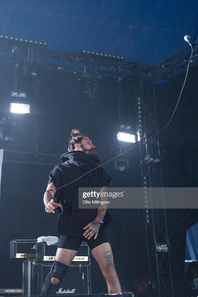 Jason Aalon Alexander Butler of letlive performs on stage at Download Festival at Donnington Park on June 13, 2014 in Donnington, United Kingdom.