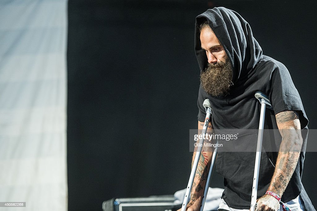 Jason Aalon Alexander Butler of letlive walks onto stage on crutches nursing a knee injury at Download Festival at Donnington Park on June 13, 2014 in Donnington, United Kingdom.