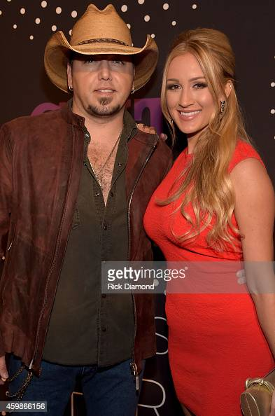Jason Aldean and Brittany Kerr attend the 2014 CMT Artists Of The Year at the Schermerhorn Symphony Center on December 2 2014 in Nashville Tennessee