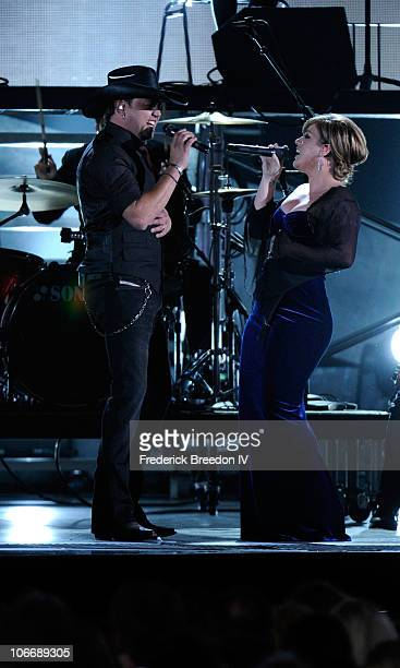 Jason Aldean and Kelly Clarkson perform onstage at the 44th Annual CMA Awards at the Bridgestone Arena on November 10 2010 in Nashville Tennessee