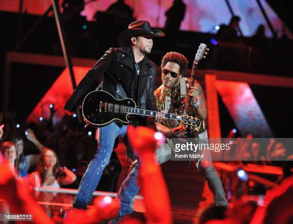 Jason Aldean and Lenny Kravitz perform during the 2013 CMT Music awards at the Bridgestone Arena on June 5 2013 in Nashville Tennessee