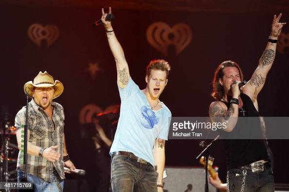 Jason Aldean Brian Kelley and Tyler Hubbard of Florida Georgia Line perform onstage during iHeartRadio Country Festival in Austin held at The Frank...