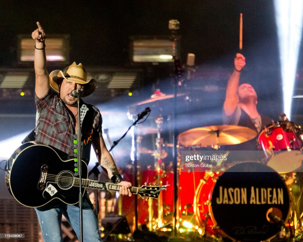 Jason Aldean, left, and drummer Rich Redmond perform at Fenway Park, Friday, July 12, 2013.