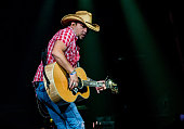 Jason Aldean performs during his 2014 Burn It Down Tour at The Palace of Auburn Hills on October 10 2014 in Auburn Hills Michigan