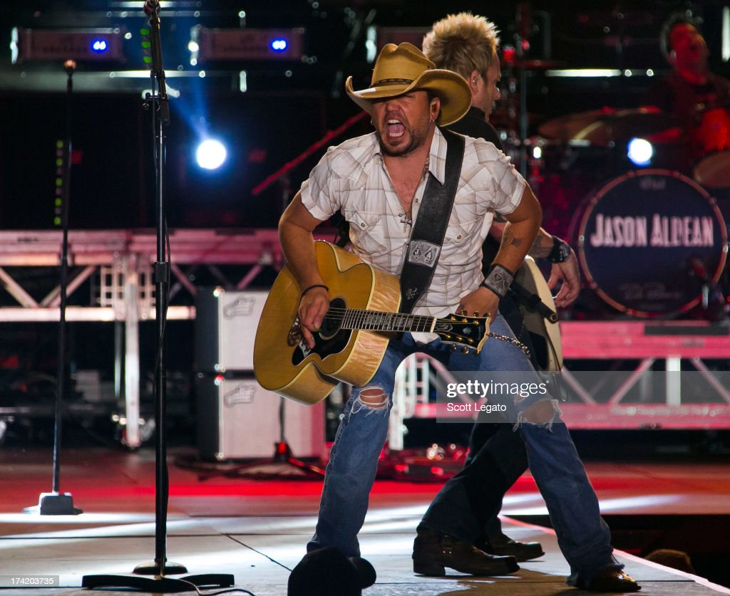 <a gi-track='captionPersonalityLinkClicked' href=/galleries/search?phrase=Jason+Aldean&family=editorial&specificpeople=619221 ng-click='$event.stopPropagation()'>Jason Aldean</a> performs during the 2013 Faster Horses Festival on July 21, 2013 in Brooklyn, Michigan.