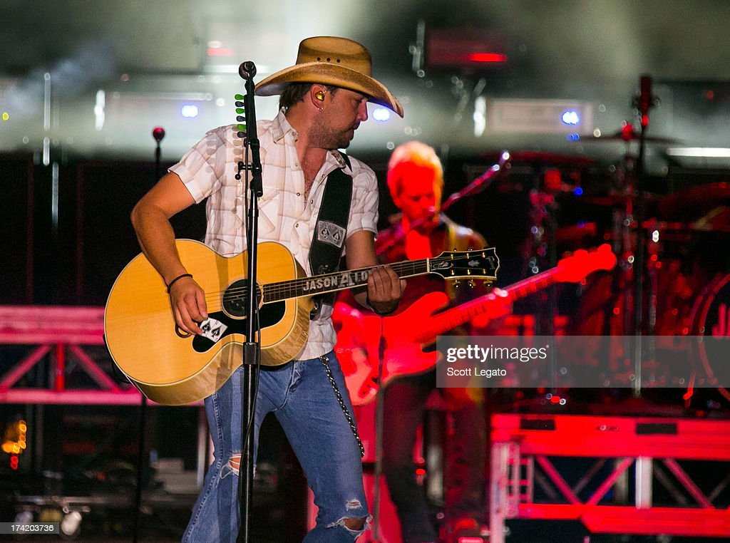 Jason Aldean performs during the 2013 Faster Horses Festival on July 21, 2013 in Brooklyn, Michigan.