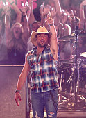 Jason Aldean performs during the 2016 CMT Music awards at the Bridgestone Arena on June 8 2016 in Nashville Tennessee