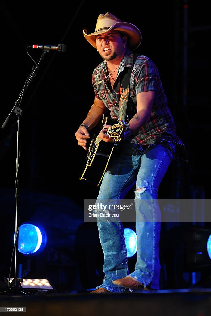 <a gi-track='captionPersonalityLinkClicked' href=/galleries/search?phrase=Jason+Aldean&family=editorial&specificpeople=619221 ng-click='$event.stopPropagation()'>Jason Aldean</a> performs during the Night Train Tour 2013 at Fenway Park on July 20, 2013 in Boston, Massachusetts.