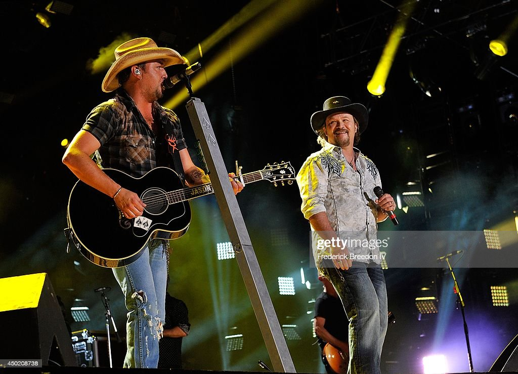Jason Aldean performs with Travis Tritt at LP Field at the 2014 CMA Festival on June 6 2014 in Nashville Tennessee