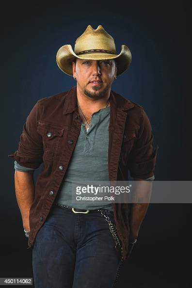 Jason Aldean poses at the 2014 CMT Music Awards Wonderwall Portrait Studio at Bridgestone Arena on June 4 2014 in Nashville Tennessee